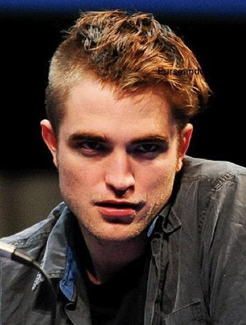 Robert Pattinson capelli rossi rasati