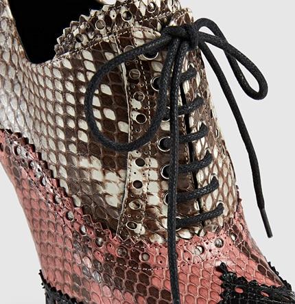 Gucci scarpa stringata in pitone traforato 1450.00 euro